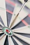 Dart Hitting Bulls Eye